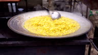 Appetizing sweet corn cooked outdoors in large bowl, barbecue party, street food video