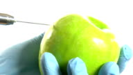 Apple injected by syringe. video