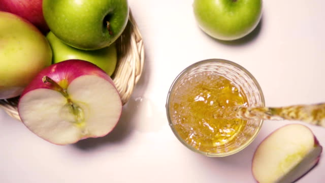 Apples on the table, and Slow Motion juice pours from above video