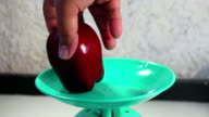 Apples on weighing scale. video