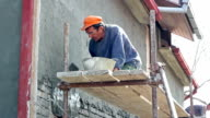 Applying Cement Render to a Brick Wall video