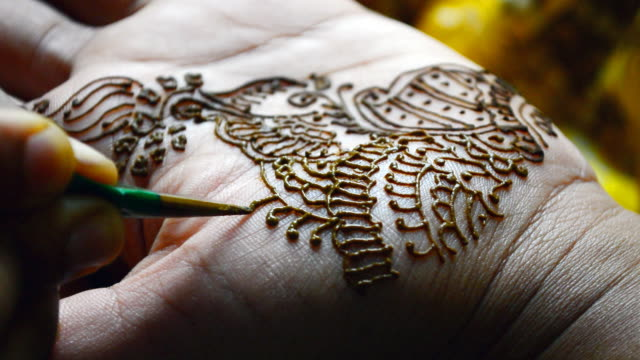 applying henna tattoo macro close up shot video