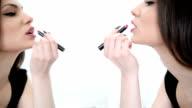 Applying lipstick video