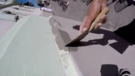 Applying plaster on the wall slow motion video