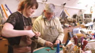 Apprentice In Bespoke Shoemaker Stitching Together Leather video