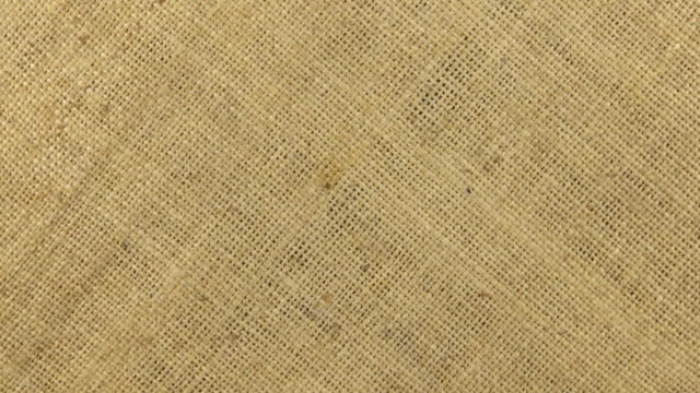 Approximation and rotation of the burlap texture, shot close-up. video