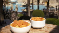 Apricot: orange fresh apricots on a pool terrace video