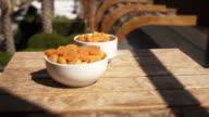 Apricot: orange fresh apricots on a pool terrace video