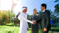 Arab business people shaking hands video
