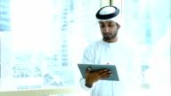 Arab businessman using digital tablet in the office video