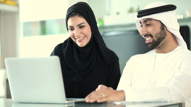 Arab Couple Planning Vacation Abroad Using Laptop video