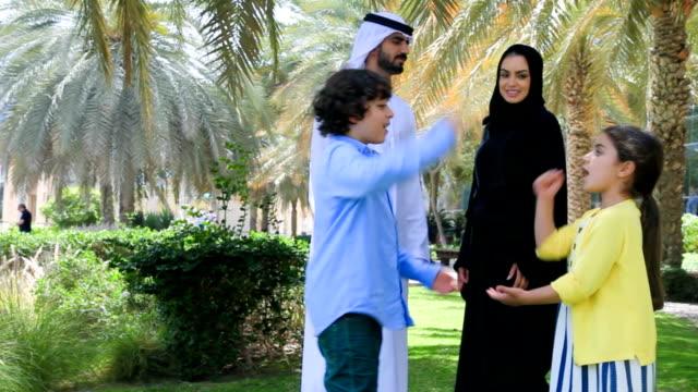Arab family enjoying in park video