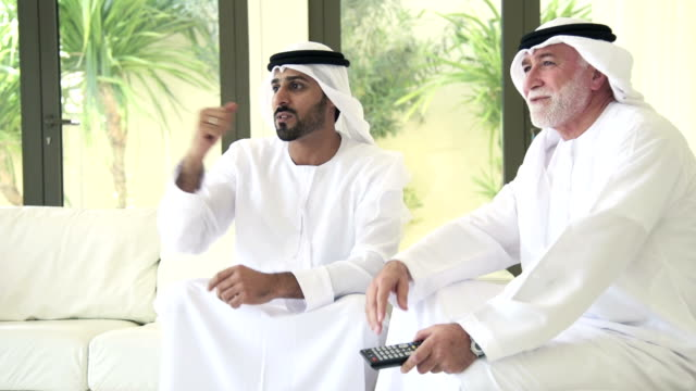 Arab Men Watching sport on television video