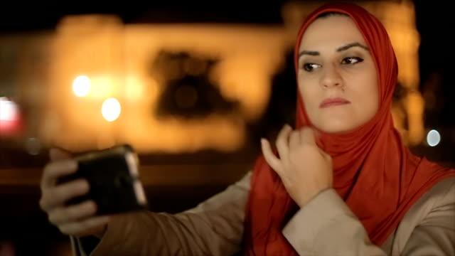 Arab woman takes selfie video