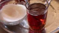 Arabian style tea glass with sugar bowl on tray video