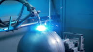 Arc welder at work on the production. From electric discharge sparks appear and scatter in different directions. Shining bright blue light video
