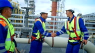 Architect and construction workers shaking hands video