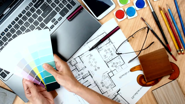 Architect Interior Designer Working At Worktable With Laptop Blue Print Video