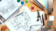 Architect - interior designer worktable with floor plan, blue print, sample video