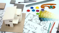 Architect & interior designer worktable with home model, blue print, color swatch video