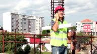 Architect With Personal Protective Equipment Using Cell Phone video
