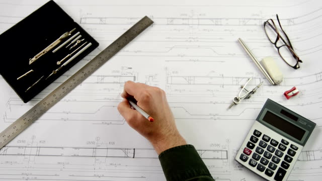 Architect Working and Calculating on Blue Print video