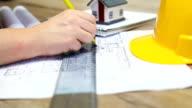 Architect working on blueprint video