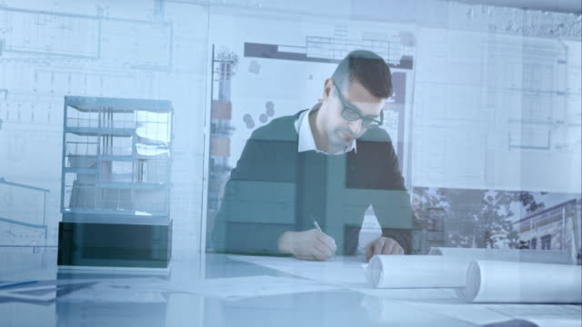 Architect working on design ideas while looking at architectural model video