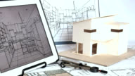 Architect working with house model & blueprints video