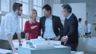 DS Architects going over the design with investing couple video