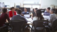 Architects Sitting Around Table Having Meeting video
