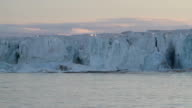 Arctic glacier calving at sunset, part two video