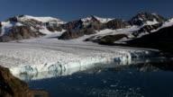 Arctic glacier calving, wide shot video