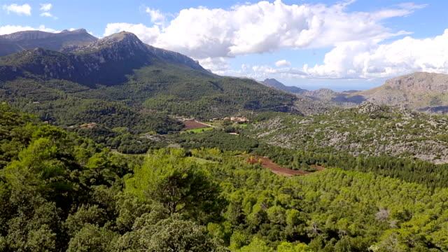 Arial View of Mountain Range Serra de Tramuntana and in the background monastery Santuari de Lluc, Majorca / Spain video