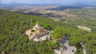 Arial View of Santuari / Ermita de Nostra Senyora de Bonany near by Vilafranca de Bonany , mountain with monastry on Majorca / Spain video