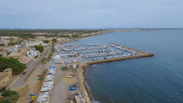 Arial View of S'Estanyol de Migjorn beach and harbor near by Sa Rapita on southern coast on Spanish Balearic island of Majorca / Spain video