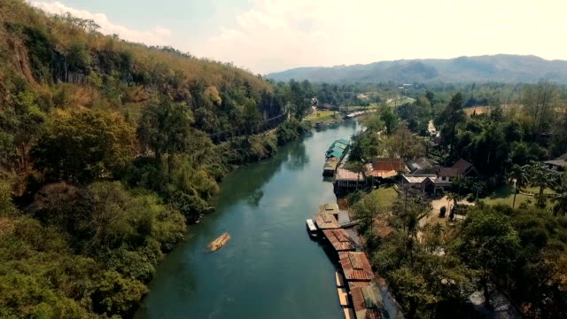 Arial View : Resort wooden house floating and mountain fog on river kwai at sai yok, Kanchanaburi, Thailand video