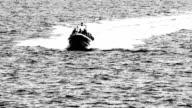 armed men on a speed boat video