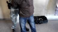 Armed policeman arresting a man video