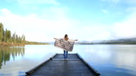Arms outstretched by a beautiful lake video