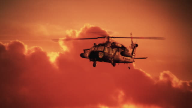 Army Helicopter on sunset background video