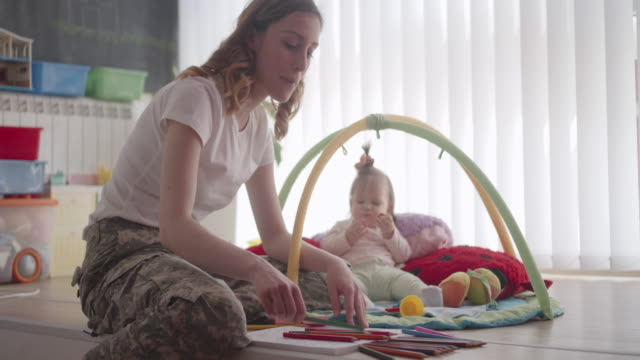 Army Mom Coloring Book for Adults and Playing With Her Baby. video