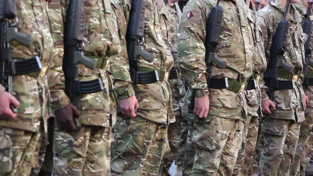 Army soldiers waiting in line - HD & PAL video