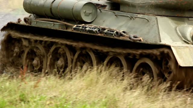 Army Tank driving through the mud video