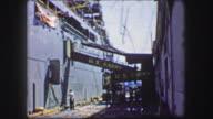 1944: US Army victory celebrate ribbon streamer ship loading ramp. video