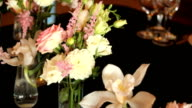 arrangement of different flowers of different colors, standing on tables for a holiday decoration video