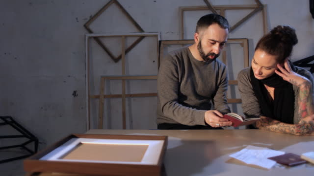 Art forger and artist looking at forged documents, dolly video
