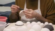 Art Studio. Young Man Painting Porcelain Cup in Art Studio. video