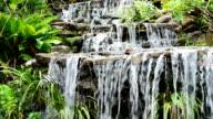 Artificial waterfall in botanic garden video