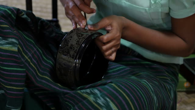 Artisan Intricately Etching a Black Lacquerware Container video